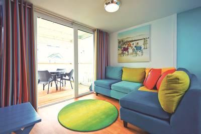 14926 Seaside Apartment BG Lounge & Balcony.jpg